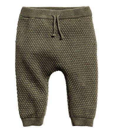 Khaki green melange. BABY EXCLUSIVE/CONSCIOUS. Moss-stitch knit pants in soft, organic cotton. Elasticized waistband with decorative tie. Ribbed hems.