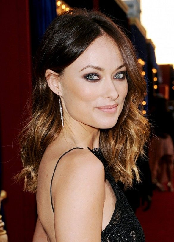 Olivia Wilde's dramatic smoky eye, paired with fresh dewy skin and pale pink lips