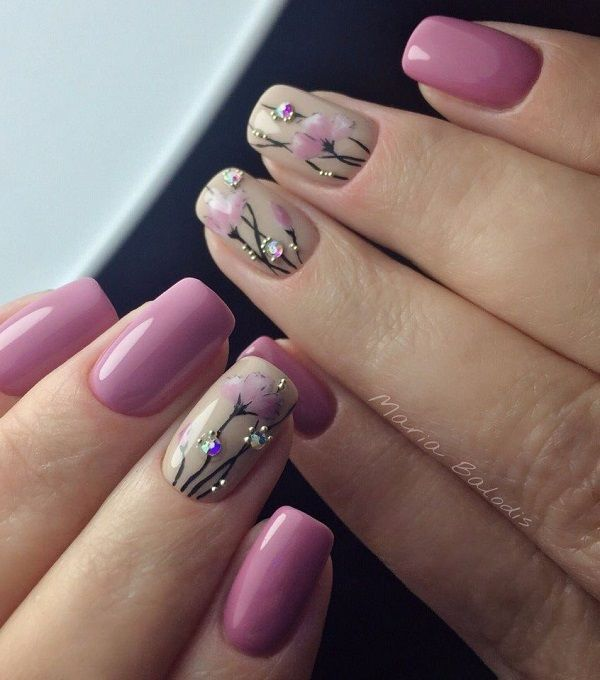 Studded Purple Flower-y Nail Art Design. Another amazing nail art design to cover this spring season is next on our list. This purple studded flower on the nude base looks amazingly perfect with the other nails fully coated in glossy purple color.
