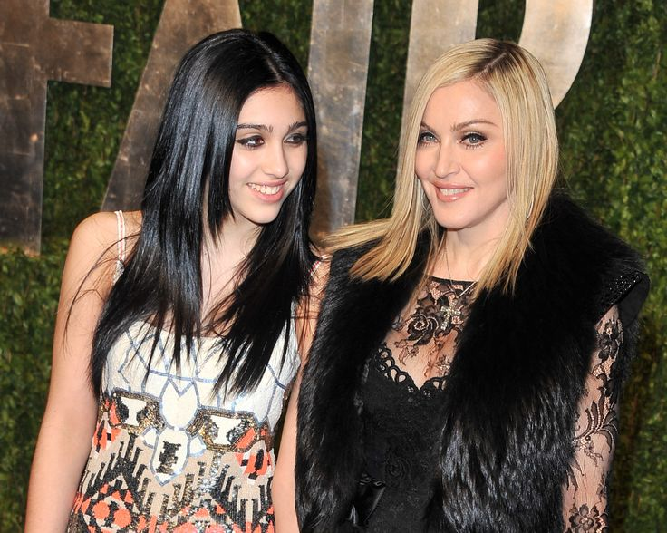 Mother-daughter duos like Cindy Crawford and Kaia Gerber have ruled fashion week this season, but they aren't the only A-list pairs who prove that good genes run in the family. Take it from Lisa Bonet and Zoë Kravitz, Reese Witherspoon and Ava Elizabeth Phillippe, or Goldie Hawn and Kate Hudson--when it comes to the red carpet, it's best to bring your family along. Here, a closer look at some of the most glamorous Hollywood mother-daughter duos and trios, from Madonna and Lourdes Leon...