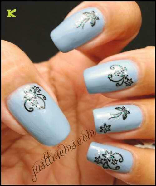 Decals on light blue polish | Nail Art | Pinterest