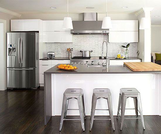 Splurge & Save Modern cabinets mix with classic elements to fashion this hip kitchen. The homeowners saved on cabinetry by purchasing IKEA components that they built and installed themselves, saving the budget about $15,000. With the savings, the couple could afford to splurge on a 48-inch professional-style range.