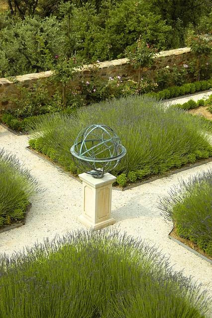 Armillary sphere in a garden by David Harber, via Flickr