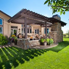 Pergola patio with fireplace.