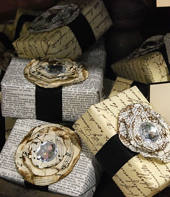 """newsprint, sheet music or french script papers for wrapping...love the paper flower and """"bling"""""""