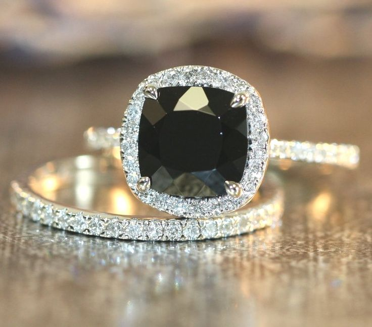 huge 3.70 carat natural black diamond with accent diamonds halo engagement ring accompanied by half eternity wedding band