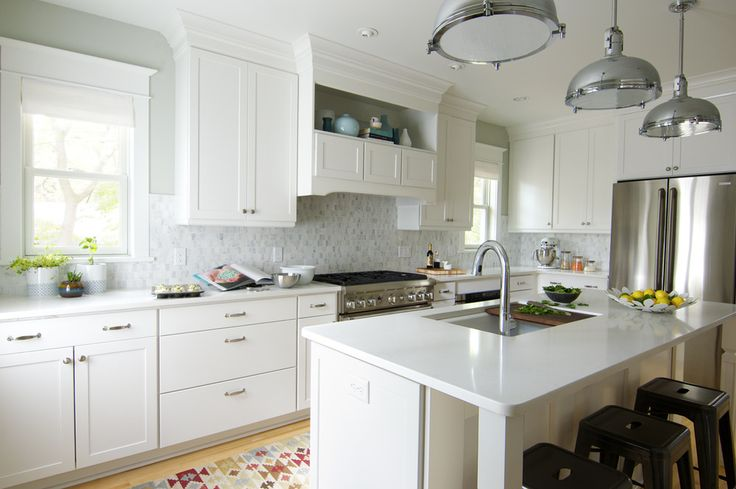 Curbly House Tour // Kitchen - After - Love the shelf above the stove and the backsplash.