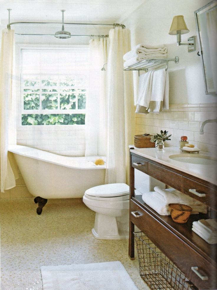 love the white tub and black feet, the shower head hanging from ceiling in the center, and the shape of the tub