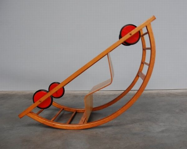 Schaukelwagen designed by Hans Brockhage & Erwin Andra in the 1950's. This German wooden toy car is also a rocking chair.