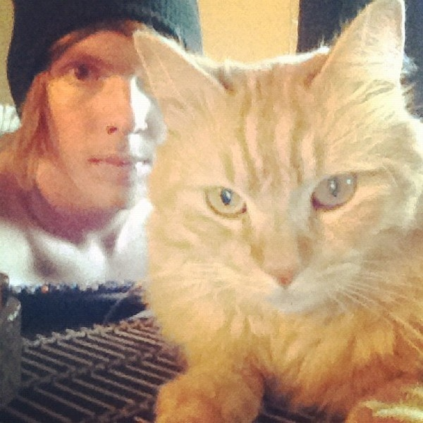Alan Ashby and his alter ego ginger cat.