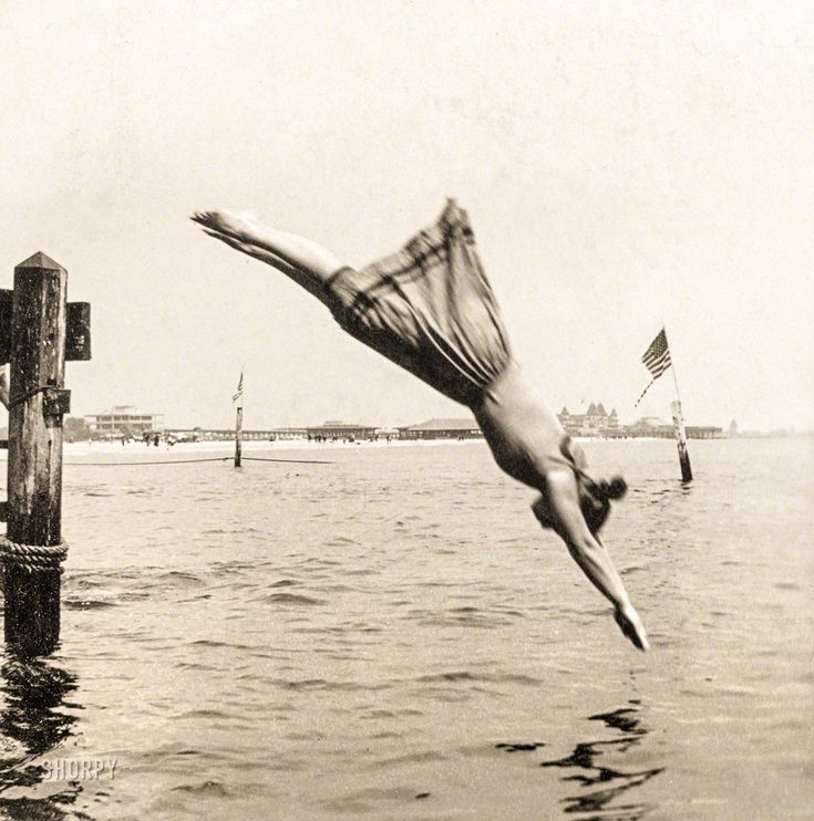 """Circa 1892. """"Woman diving from pier."""" Albumen print from """"J.S. Johnston's series of American stereoscopic views,"""" 1889-1892.