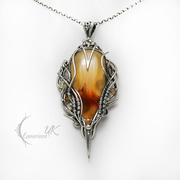 FIRE OF ELVINHTIEEL silver agate quartz by LUNARIEEN necklace pendant amulet elf elven mithrel gem gemstone equipment gear magic item | Create your own roleplaying game material w/ RPG Bard: www.rpgbard.com | Writing inspiration for Dungeons and Dragons DND D&D Pathfinder PFRPG Warhammer 40k Star Wars Shadowrun Call of Cthulhu Lord of the Rings LoTR + d20 fantasy science fiction scifi horror design | Not Trusty Sword art: click artwork for source