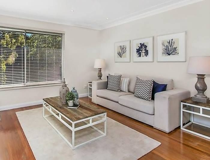 A stylish set of prints and some gorgeous cushions give this Warriewood living room a relaxed and comfortable ambiance.
