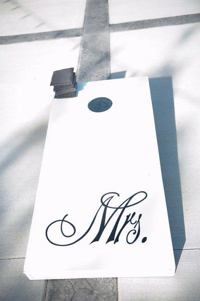 Mrs. corn hole board - what could be better?! #weddinggames #weddingideas #cocktailhour {Rae Marshall Wedding Photography}