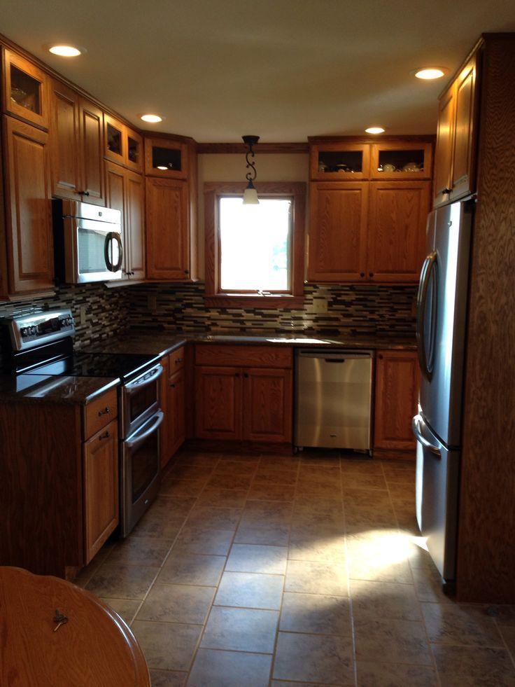 Kitchen Backsplash And Quartz Counter Tops With Oak Cabinets