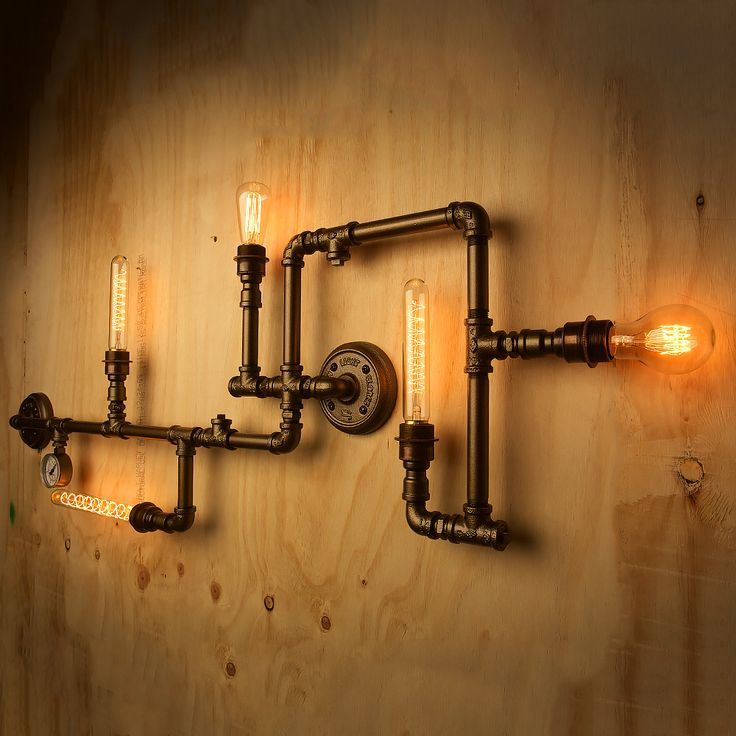 Plumbing Pipe 5 bulb wall feature consists of lengths of pipes, elbows, cross's and tee's that sit close to a wall.