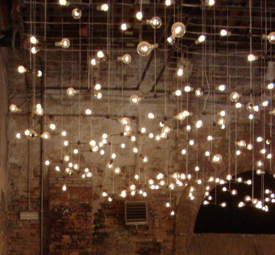 Remove all the lighting in the basement and thread tons of bulbs through the beams