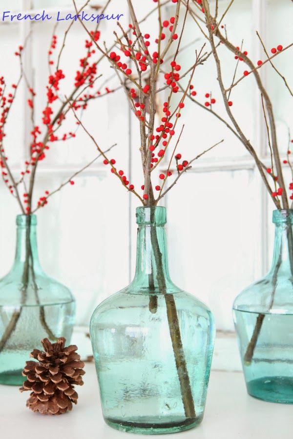 Winterberry branches in bottles.