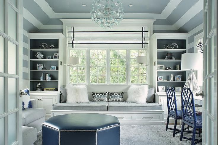 Gorgeous gray home office boasts dynamic features such as a gray tray ceiling with white accent trim.