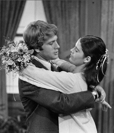 """Ryan O'Neal and Actress Ali MacGraw On the Film Set Of Arthur Hiller's """"Love Story"""""""