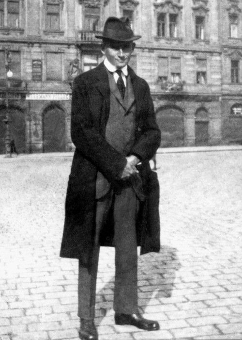 Franz Kafka in front of his family's apartment at the Oppelt House in Prague, 1922