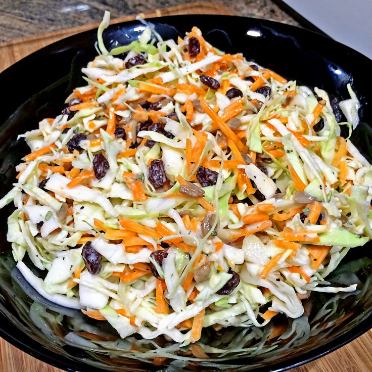 Peachy Coleslaw - For my Peachy Coleslaw dressing I omit any mayonnaise and use a peach yogurt with tarragon and apple cider vinegar, pepitas and raisins to finish it off.