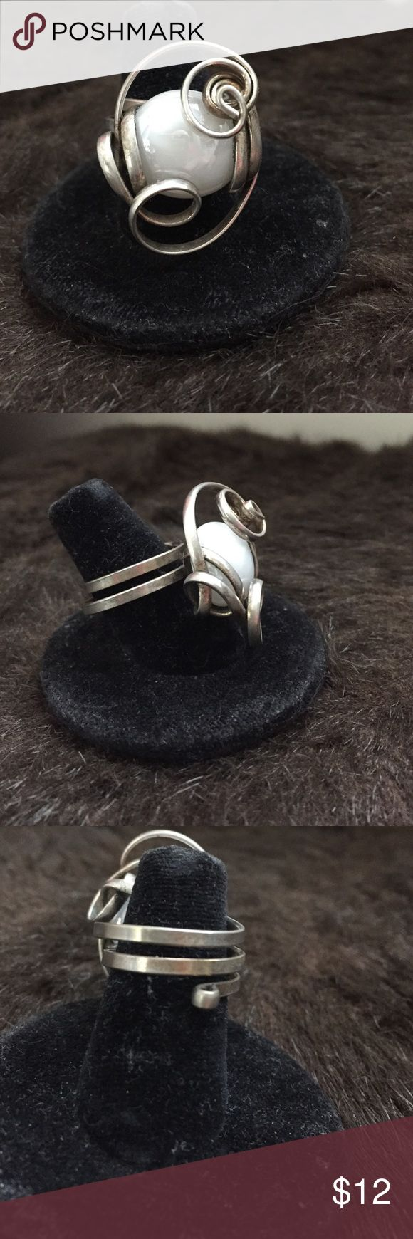 Jeweler Wire Ring Sterling jeweler wire ring with white pebble stone in center. Very different. All these rings are to big for me or I would not be selling them. 😞. Pre loved. Excellent condition Jewelry Rings