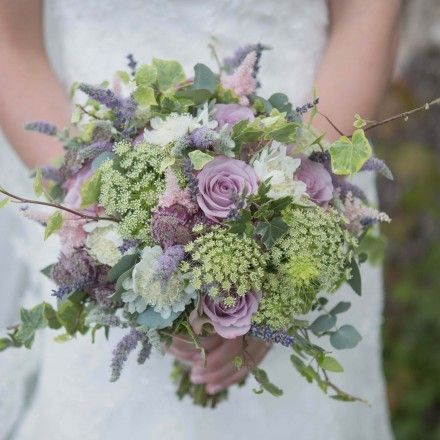 rustic bridal bouquet with dried lavender, flowering mint, lilac roses and rustic ivy