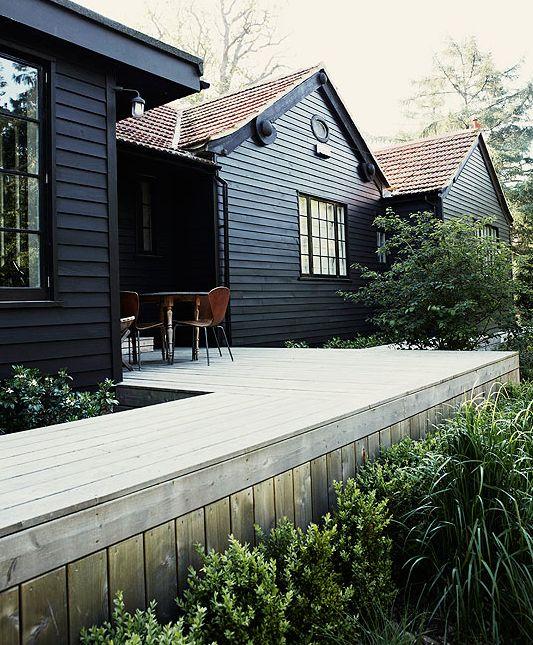 black house and green garden