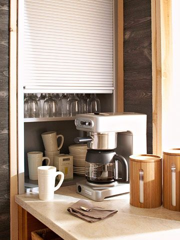 An appliance garage serves an build in on side of fridge? - alternate purpose: keeping cups and glassware corralled in a corner dedicated to making drinks.