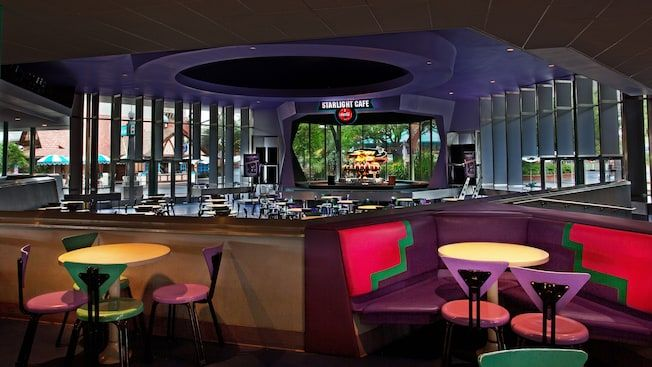 Dining area looking down on sunken dining room and stage at Cosmic Ray's Starlight Café