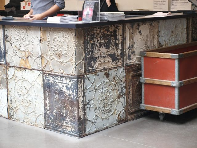 ceiling tin counter - would be cool facing for a kitchen breakfast bar (from: shop in Merci, Paris)