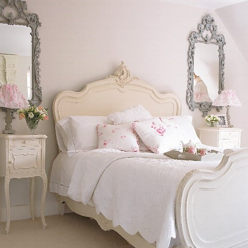 Love the creamy paint on the bed and the Cabbages & Roses Fabric pillows