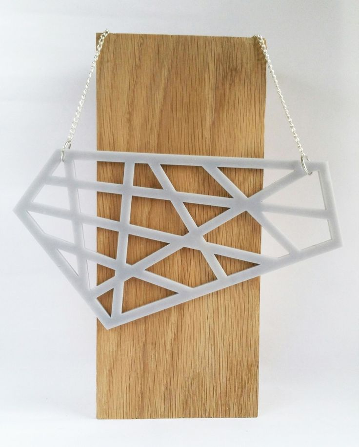Truly stand out from the crowd in this eye-catching geometric asymmetrical neckacle. As seen on www.styledoctors.comThe large laser cut pendant hangs from a silver plated curb chain and features an Emmie Lou brand tag to ensure you are purchasing a genuine Emmie Lou piece.Measurements: Width / 21 cm Height / 8 cm Chain / 42 cm To care for your necklace, please keep it away from water. It is advisable to put perfume on before you put on your jewellery to avo...
