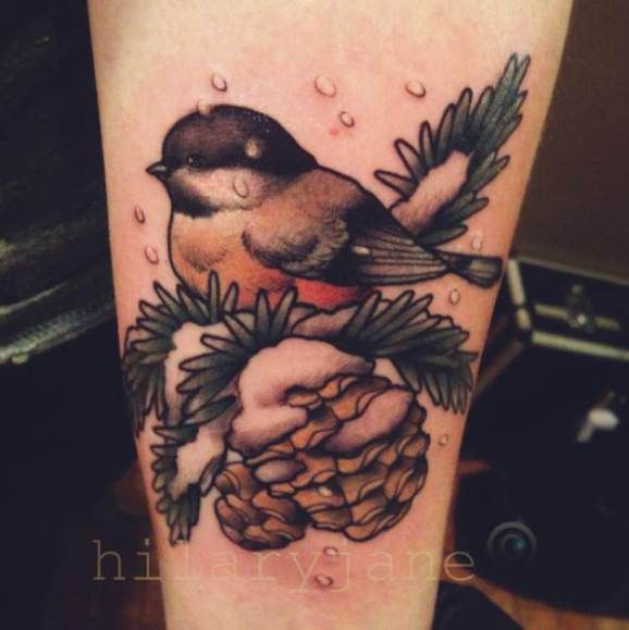 Little Snowman Tattoos | realistic style bird sitting on a pine cone by Chickadee Tattoo