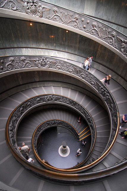 The spiral staircase at the Musei Vaticani, leading one to the exit. Giuseppe Momo, 1932.
