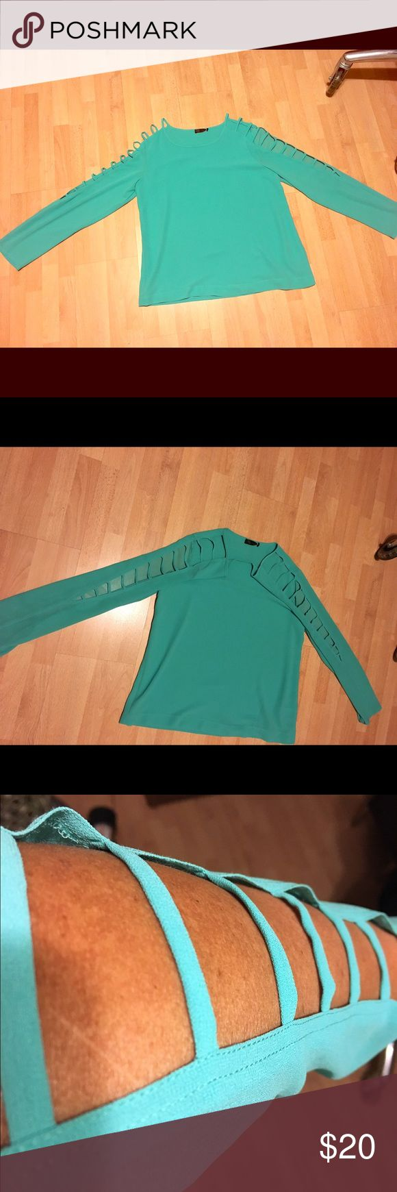Long sleeve blouses with cut outs Beautiful turquoise shirt with cut out sleeves. The front of the shit us lined. It had a round neck. kld signiture Tops Blouses