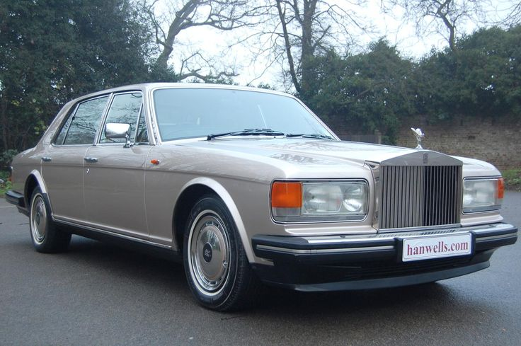 1994 L Rolls Royce Silver Spur III. Finished in Silica with quarter badges and whitewall tyres. The interior is in Soft Tan with electric rear seats and picnic tables. Only 21,900 miles and in immaculate condition throughout. Must be seen £23.950 Full Details:  http://hanwells.net/rolls-royce-select/rolls-royce-silver-spur/1994-l-rolls-royce-silver-spur-iii-in-silica-23-950