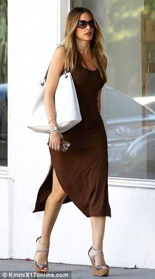 Old pro: The chunky footwear didn't seem to slow Sofia down as she strode out on her way to check out fine linens at an upscale store