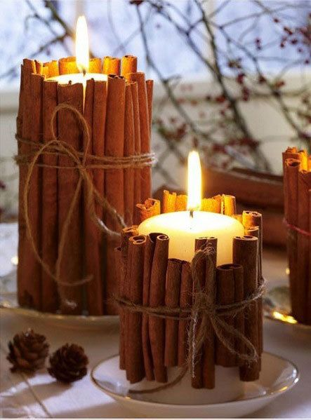 Black candles surrounded by cinnamon sticks and ribbon. A pretty decorating idea for fall.