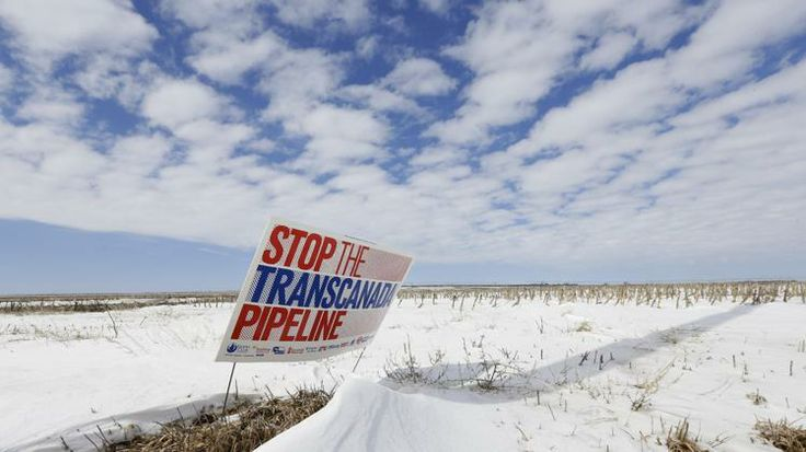 "In this March 11, 2013, file photo, a sign reading ""Stop the Transcanada Pipeline"" stands in a field near Bradshaw, Neb. The proposed Keysto..."