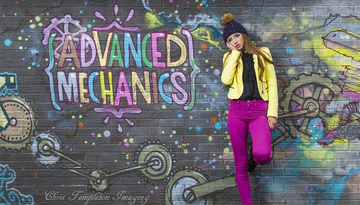Colorful model posed against a graffiti wall.