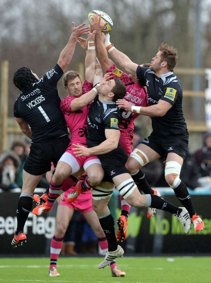 Will Welch (R) of Newcastle Falcons takes the ball during the Aviva Premiership rugby match between Newcastle Falcons and London Welsh at Kingston Park on January 11, 2015 in Newcastle upon Tyne, England. (Photo by Nigel Roddis/Getty Images)