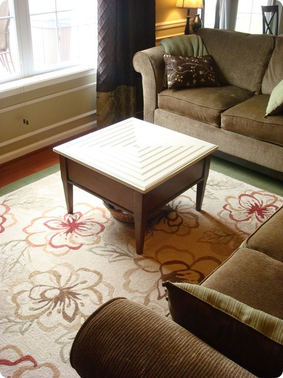 """What a great table from the """"Thrifty Decor Chick.  She made miter cuts on beadboard and started from the outside and worked in, creating a square design and incased with inexpensive molding."""