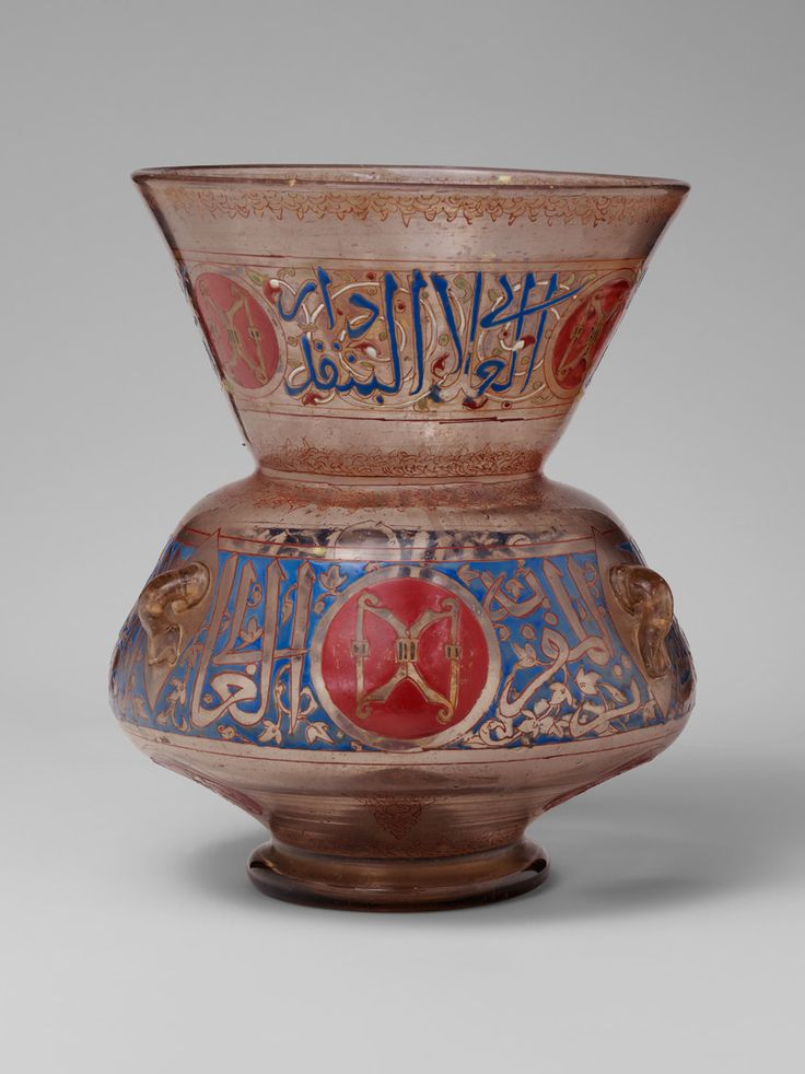 Mosque Lamp for the Mausoleum of Amir Aydakin al-'Ala'i al-Bunduqdar, shortly after 1285. Egyptian. The Metropolitan Museum of Art, New York. Gift of J. Pierpont Morgan, 1917 (17.190.985) | The two gold crossbows against a red shield indicate that the patron of this lamp held the high-ranking office of bunduqdar (keeper of the bow) at the Mamluk court. #OneMetManyWorlds