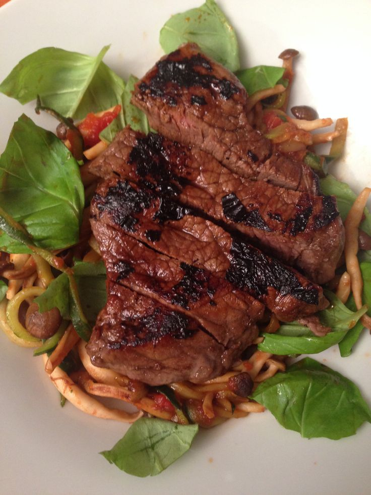 Marinated beef (balsamic vinegar, olive oil, mustard powder, salt, pepper) served with enoki mushrooms cooked with tomato and basil
