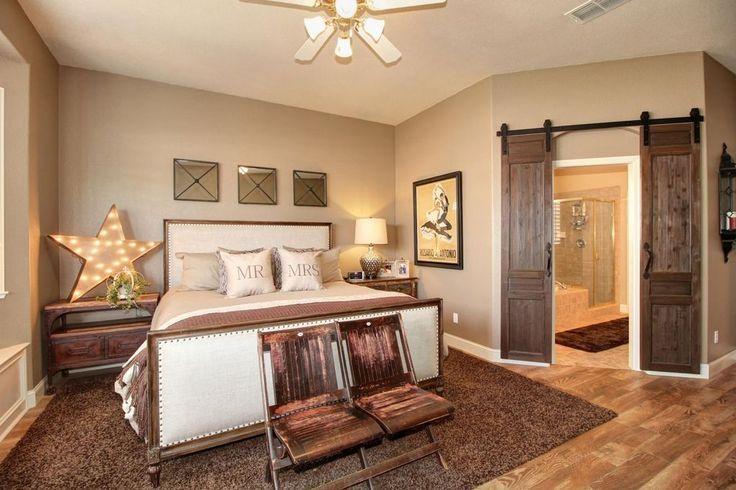 Country Master Bedroom with Rustica Hardware Industrial Barn Door Hardware, Hardwood floors, flush light, Drop-In Bathtub