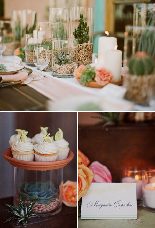 beautiful succulent spread. hurricanes with succulents and white pillars in trays with loose pink flowers and succulents
