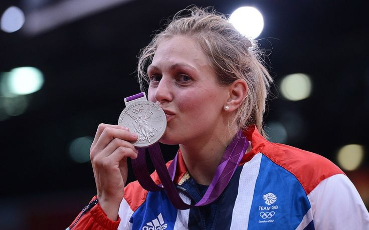 Britain's Gemma Gibbons kisses her silver medal after the podium ceremony of the women's -78kg judo contest of the London 2012 Olympic Games