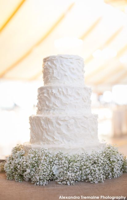Baby's Breath detail on a simple wedding cake..pretty with Burlap on a whiskey barrel... ivory icing.